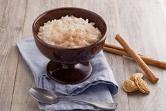 Rice pudding with cinnamon and almonds royalty free stock images