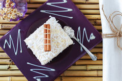 Rice pudding  with coconut, condensed milk and cinnamon on purpl Royalty Free Stock Image