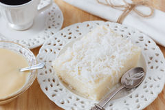 Rice pudding with coconut on white plate with cup of coffee and Royalty Free Stock Photos