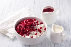 Rice pudding with cranberry jam and fresh cranberries Stock Photos