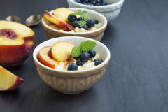 Rice pudding dessert with blueberry and peach Stock Image