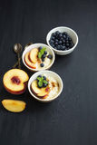Rice pudding dessert with blueberry and peach Stock Images