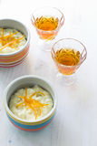 Rice pudding dessert topped with orange peel Stock Photo