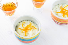 Rice pudding dessert topped with orange peel Stock Images