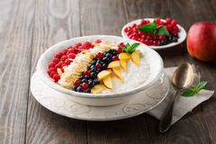 Rice pudding with fresh fruits Royalty Free Stock Photography