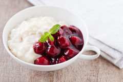 Rice pudding with hot cherries Royalty Free Stock Photos