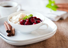 Rice pudding with hot cherries Stock Photo