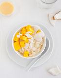 Rice pudding with mango and coconut water in a bowl, khao niaow ma muang White background Stock Photos