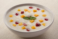 Rice Pudding with mango, honey.Healthy breakfast. Stock Photography