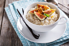 Rice pudding with milk and vanilla beans. Garnished with figs Stock Image