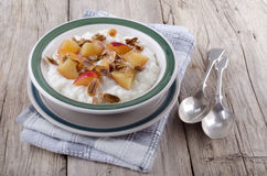 Rice pudding and nectarine piece Stock Photos