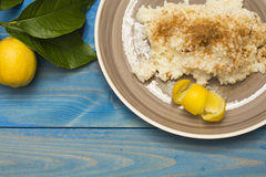 Rice pudding. Plate with  on the table, lemon on the table Stock Images