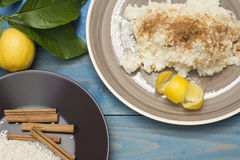 Rice pudding. Plate with  on the table, lemon on the table Stock Image