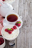 Rice pudding with raspberries Stock Photos