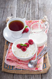 Rice pudding with raspberries Stock Image