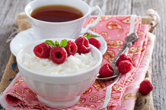 Rice pudding with raspberries Stock Photo