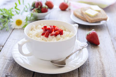 Rice pudding with slice of strawberry Stock Photo