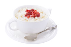 Rice pudding with slice of strawberry on white background Royalty Free Stock Image