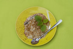 Rice pudding. And sprinkled cinnamon, on the table Royalty Free Stock Photos