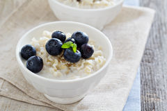 Rice pudding with syrup and berries Stock Photography