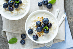Rice pudding with syrup and berries Royalty Free Stock Photography