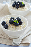 Rice pudding with syrup and berries Stock Image
