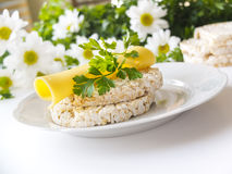 Rice puffed cakes with cheese, parsley and chamomile flowers Royalty Free Stock Photography