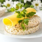 Rice puffed cakes with cheese, parsley and chamomile flowers Royalty Free Stock Photos