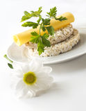 Rice puffed cakes with cheese, parsley and chamomile flowers Stock Images