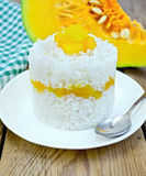 Rice with pumpkin on board Royalty Free Stock Photos
