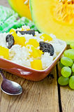 Rice with pumpkin and prunes on the board Stock Photo