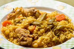 Rice with rabbit and vegetables. Paella rice with meat and vegetables Royalty Free Stock Photo