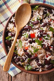 Rice with red beans in a bowl close-up on the table. vertical to. Rice with red beans in a bowl close-up on the table. vertical view from above Royalty Free Stock Photography