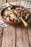 Rice with red beans and other vegetables in a bowl. vertical. Rice with red beans and other vegetables in a bowl on the table. vertical stock photography