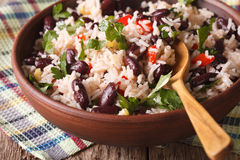 Rice with red beans and other vegetables close-up. horizontal. Rice with red beans and other vegetables in a bowl close-up on the table. horizontal stock photos