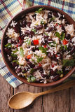 Rice with red beans and vegetables in a bowl close-up. vertical. Rice with red beans and vegetables in a bowl close-up on the table. vertical view from above stock photography