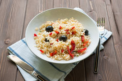 Rice with red capsicum and black olives Stock Photography