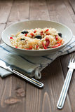 Rice with red capsicum and black olives Royalty Free Stock Photo