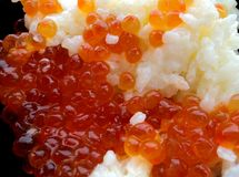 Rice with red caviar. In black chalice Royalty Free Stock Photo