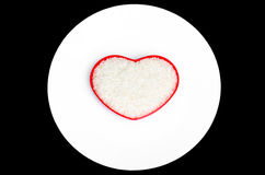 Rice in red heart shape dish Royalty Free Stock Photos