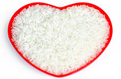 Rice in red heart shape Royalty Free Stock Image