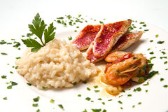 Rice with red mullet fillets and seafood Stock Image