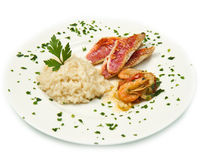Rice with red mullet fillets and seafood Royalty Free Stock Image