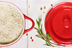 Rice on a red saucepan Royalty Free Stock Photo