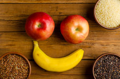 Rice: red, white and black, and smile with fruit. Royalty Free Stock Photography