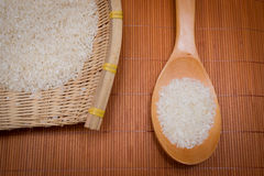 The rice in a rice scoop and bamboo basket Stock Photography