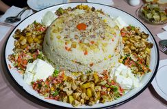 Rice Risotto with chicken meat, potato, green pea, carrot, sliced tomato and yoghurt on tray. Turkish traditional food Rice Risotto with chicken meat, potato Stock Images