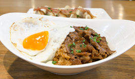 Rice with roast beef  barbecue sauce and fried egg. For dinner Royalty Free Stock Image