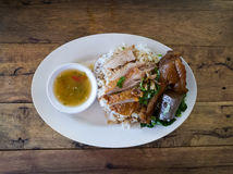Rice with roast duck. On white plate Stock Photo