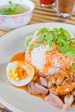 Rice with roasted pork with sauce. Stock Photos